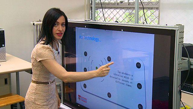 LJ Rich demonstrating touchscreen