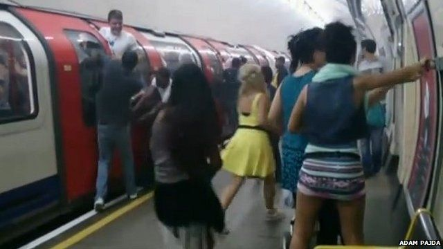 Passengers at Holland Park station during the evacuation