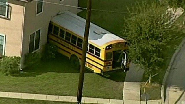 School bus crashes into house