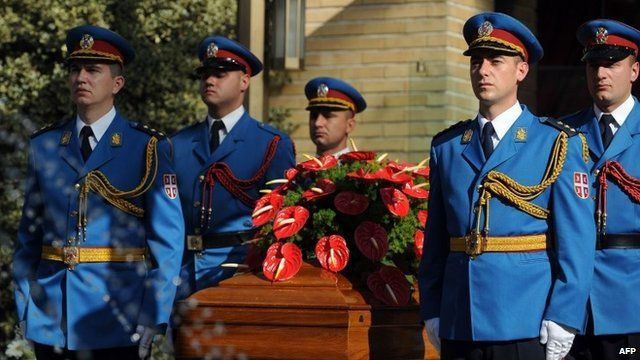 Military honour guard around coffin