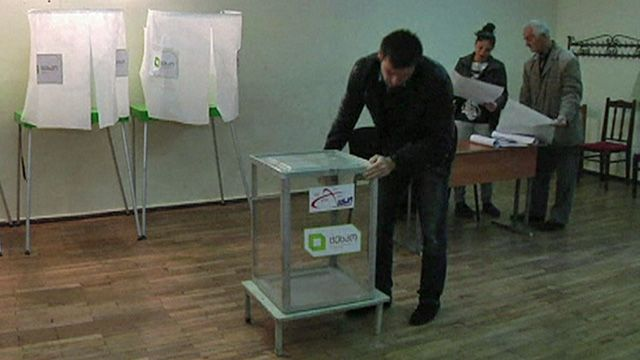 Election helpers setting up ballot boxes