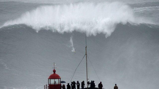 Carlos Burle rides a huge wave
