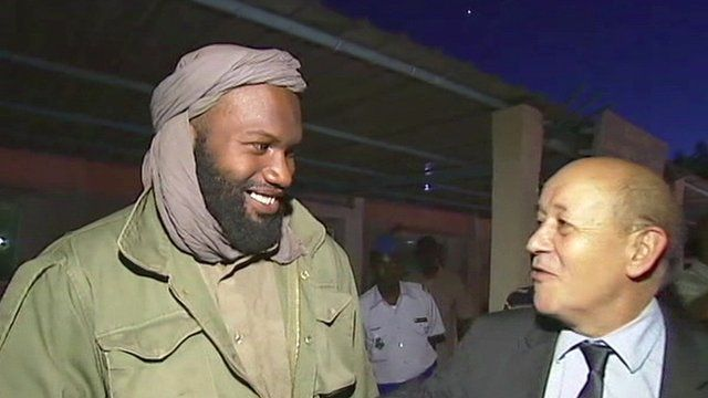 One of the freed hostages (left)