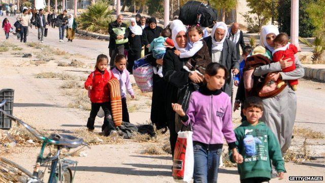 Syrian civilians evacuate Moadamiya, the war-battered suburb of Damascus