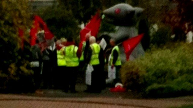 Demonstrators from Unite gather outside the driveway of the home of a Grangemouth company boss in Fife, with a giant inflatable rat