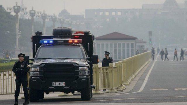 Armed police in Beijing's Tiananmen Square, 31 October 2013
