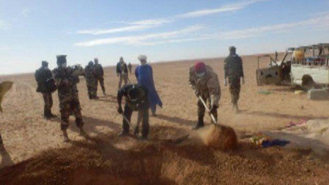 Men digging in the Sahara desert