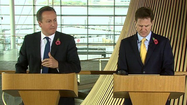 David Cameron and Nick Clegg speaking at the Welsh Parliament