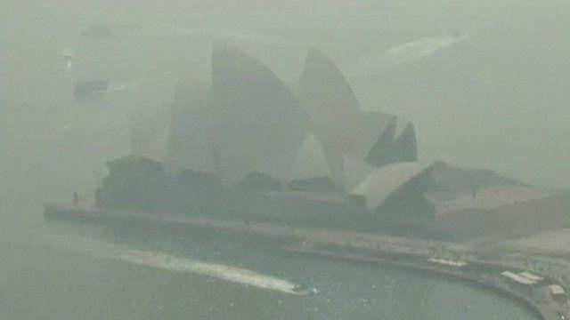 Sydney Opera House shrouded by smoke