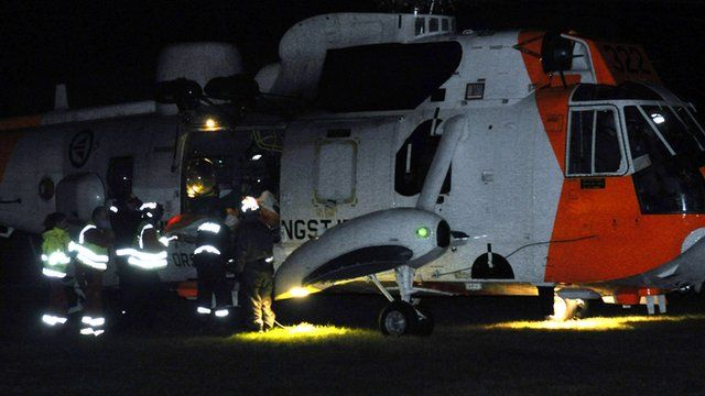 Emergency services surround a helicopter near the site of a bus hijacking in Årdal, western Norway