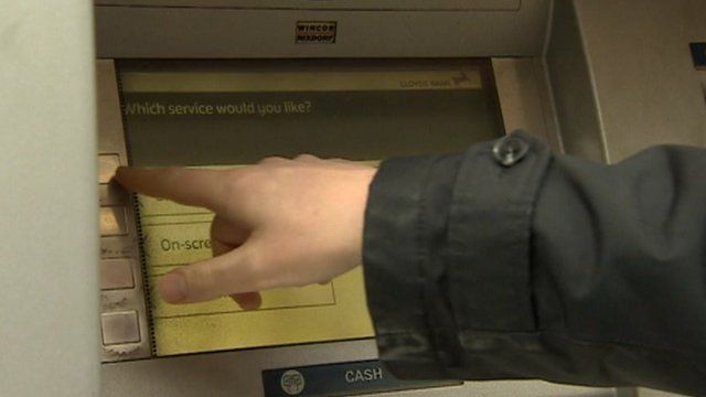 Cash machine being used