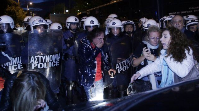 ERT staff and supporters and riot police outside the former state broadcaster
