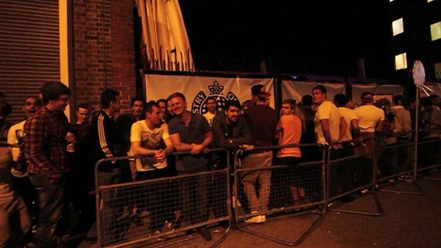 Revellers queue for the Ministry of Sound