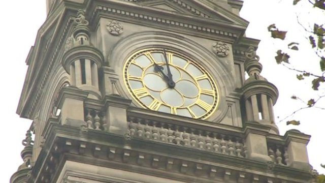 A clock strikes the eleventh hour on Armistice Day 2013