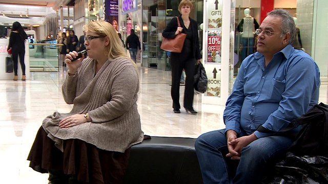 Katherine Devlin smoking an e-cigarette in a shopping centre