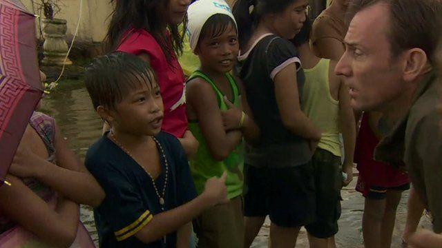 Children queue for rice