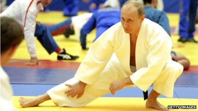 Putin trumps Chuck Norris in black belt stakes