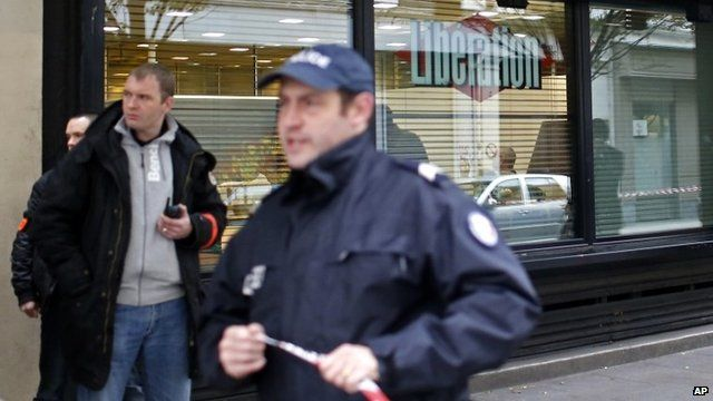 Police outside offices of Liberation