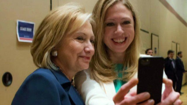 "Hillary and Chelsea Clinton taking a ""selfie"""