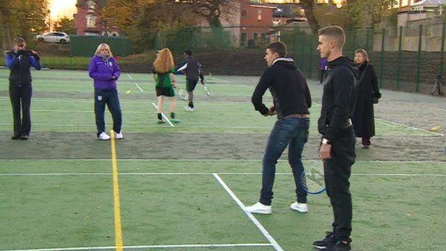 People playing tennis