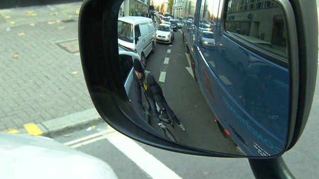 View of cyclist through lorry's mirror