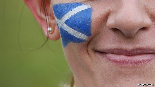 Woman with Scottish flag painted on cheek