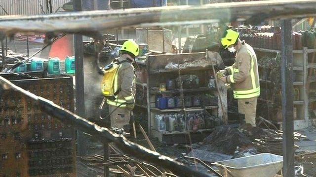Fire crew sort through items at the garden centre