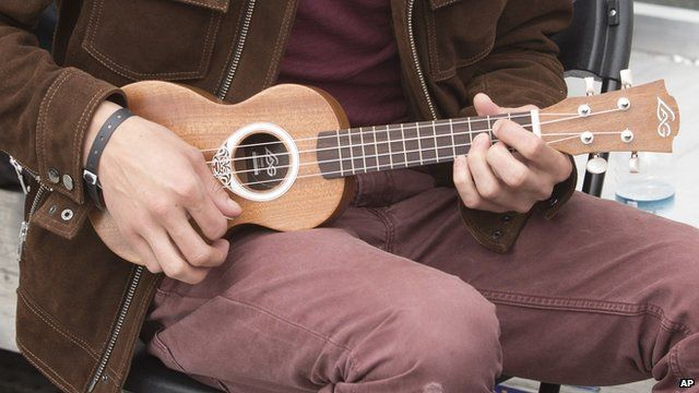 Boy playing a ukulele