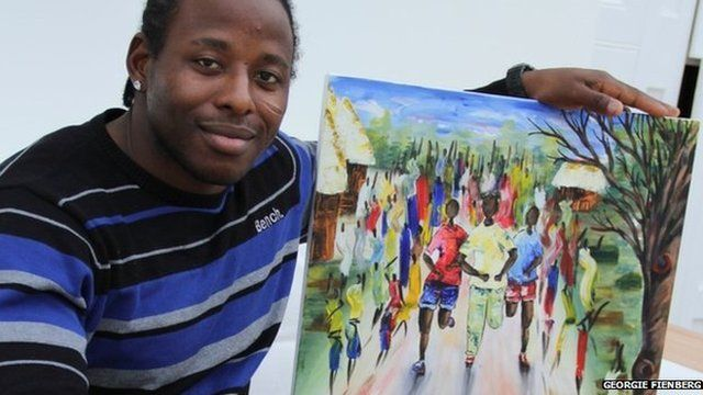 Paul Apowida with a painting
