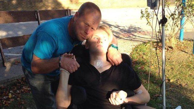 Mark Smith with his son Ryan