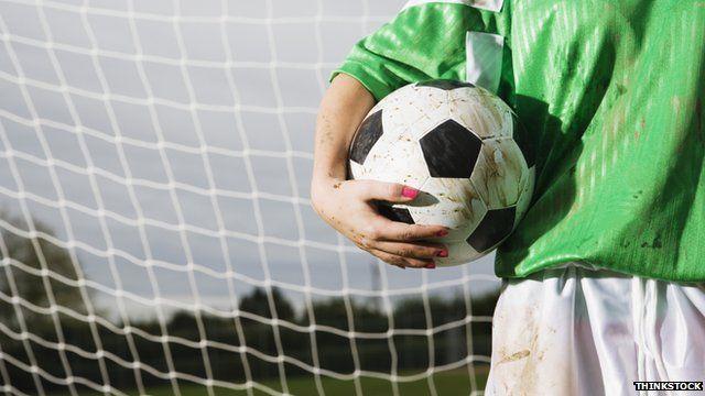 Goalkeeper holding a football