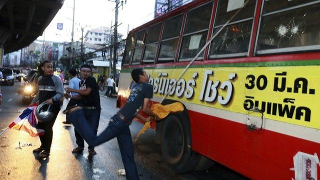 Anti-government protesters attack a bus