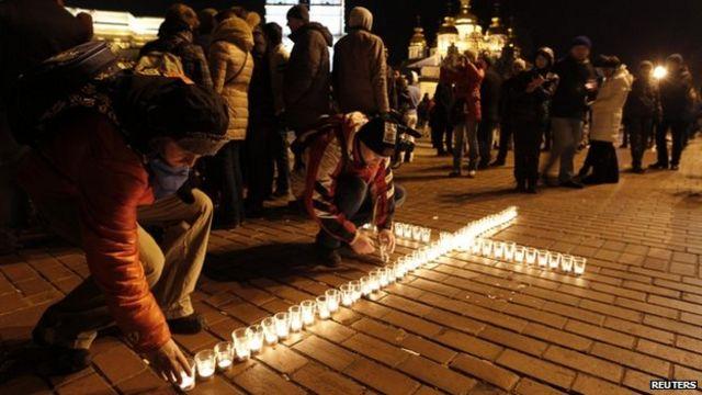 Ukraine protests: Thousands march through capital