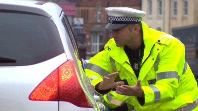 An officer talks to a driver