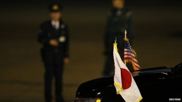 National flags of Japan and US on car carrying US Vice-President Joe Biden