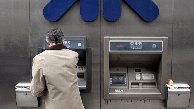man using RBS cashpoint