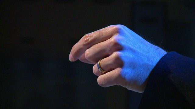 A hand controlling a ultrasound powered device