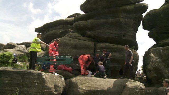 Rescue team attend to the fallen climber
