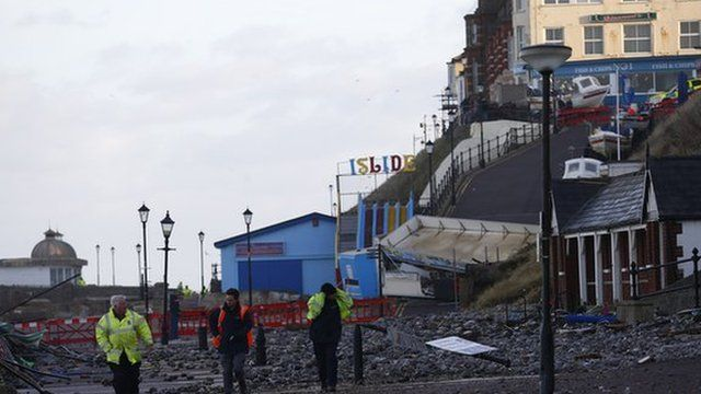 Workers assess damage in Cromer, East England