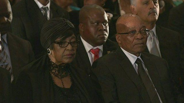 Winnie Mandela and President Jacob Zuma attend a memorial service for Nelson Mandela