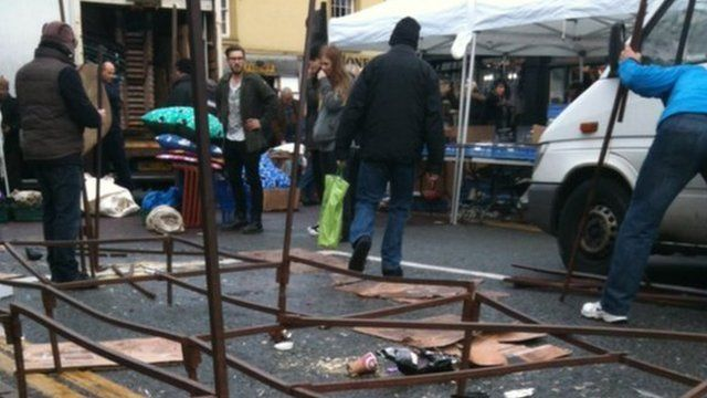 Market traders cleared up the aftermath