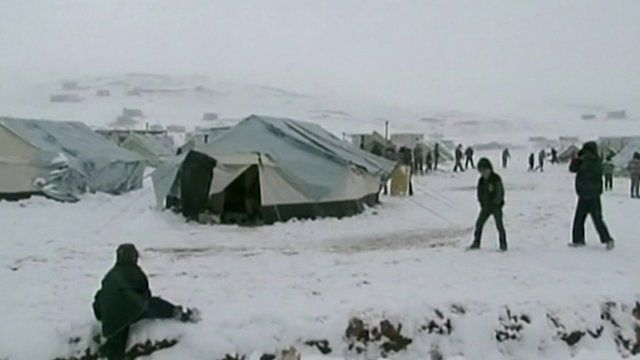 Refugees in makeshift homes