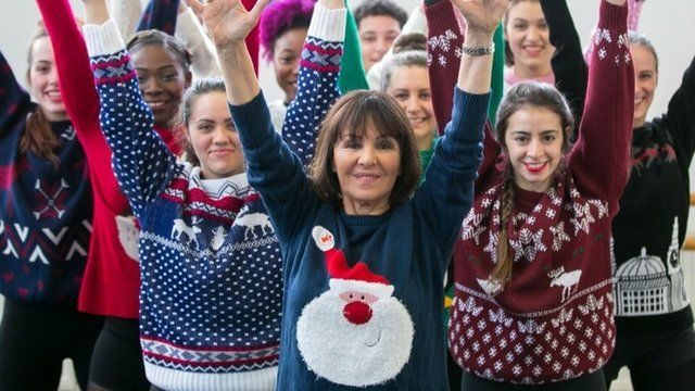 People wearing Christmas jumpers