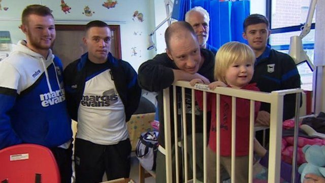 Ipswich Town players delivering gifts