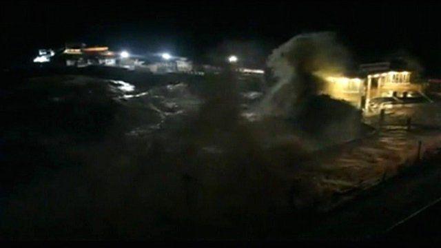 Tidal surge crashing against Cromer Pier