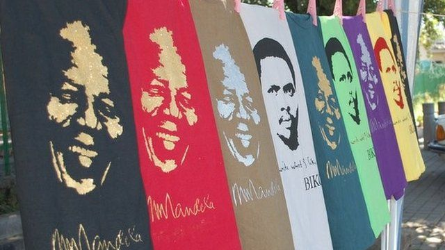Mandela's face on T-shirts in gold