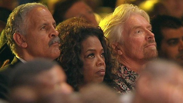 Oprah Winfrey sits with her partner Stedman Graham, left, and British entrepreneur Sir Richard Branson