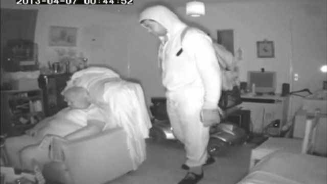 Man breaking into a woman's home