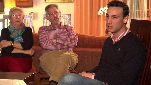 Alberto Barragan (R) and his parents