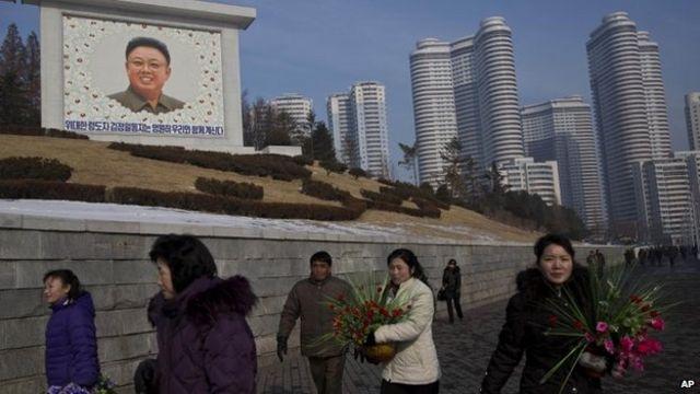 North Korea marks Kim Jong-il death amid purge tensions